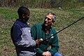 Regional Director Tom Melius Shares Fishing Wisdom with Student (8740182015).jpg