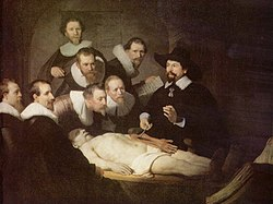 "Painting by Rembrandt titled ""The Anatomy Lesson of Dr. Nicolaes Tulp"", depicting a bearded doctor in a hat dissecting the left arm of a cadaver in front of seven men"