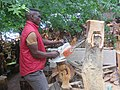 Right Mukore carving a tree into a woman lifting a heart at Montebello Bibiloucapetown Essay Photo 5.jpg