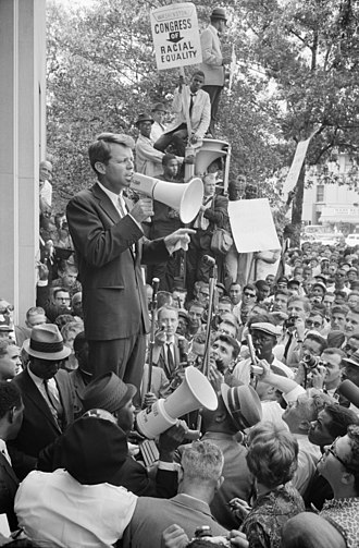 Congress of Racial Equality - A CORE sign displayed as Robert F. Kennedy speaks to a crowd outside the Department of Justice Building in June 1963
