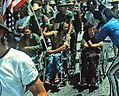Ron Kovic and Vietnam Veteran protestors at the 1972 Republican National Convention being filmed by a camera man - Miami, Florida (cropped).jpg