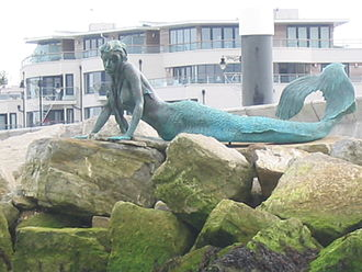 Royal Yacht Squadron - The Bronze Mermaid by Jonathan Wylder on the breakwater of the RYS Haven, which was modelled on Sharron Davies