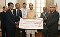 S.N. Mantha presenting a final dividend cheque of Rs. 11.10 Crore to the Union Minister for Finance, Corporate Affairs and Defence, Shri Arun Jaitley, in New Delhi. The Secretary (Defence Production), Shri G. Mohan Kumar.jpg