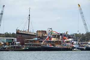 Sydney Heritage Fleet - The Sydney Heritage Fleet restoration shipyard at Rozelle Bay, New South Wales. The vessels in the image include the steam tug Waratah, the harbour ferry Kanangra, and the pilot vessel John Oxley.