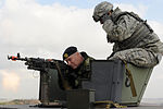 SSG Troy Haugh, 8th Security Forces Squadron, shows Rear Admiral Anders Grenstad how to fire a machine gun on Kunsan AB.jpg