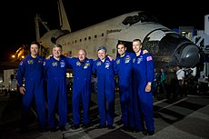 The crew of STS-134 pose for a picture on the runway at Kennedy Space Center after Space Shuttle Endeavour's final landing. Image: NASA / Bill Ingalls.