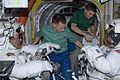 STS-135 EVA preparations in the Quest airlock.jpg