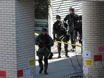 A SWAT team enters the CII building of Renssel...