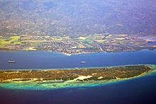 Aerial View Of San Carlos City, With Refugio/Sipaway Island In Foreground.