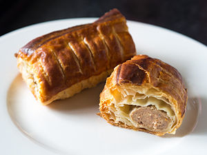 Sausage roll - A Dutch sausage roll (saucijzenbroodje) showing the puff pastry surrounding the roll of minced meat inside.