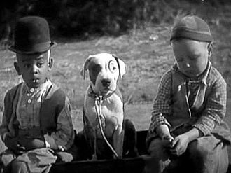 "Pete the Pup - Pete the Pup, center, with Matthew ""Stymie"" Beard and Bobby ""Wheezer"" Hutchins in the Our Gang comedy School's Out, 1930."
