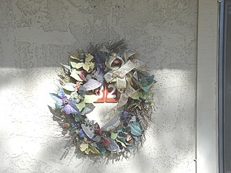 Bob Crane - A funeral wreath on the door of apartment 132A.