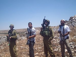 IDF soldiers and Israeli settlers
