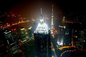 Jin Mao Tower - The four mechanical stories forming the spire of the building are brightly illuminated at night.