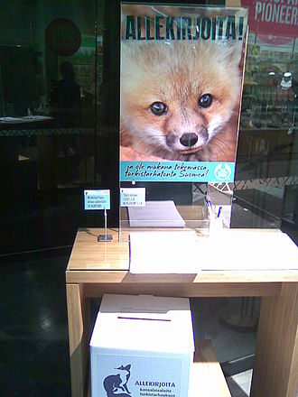 Initiative - Signature collection point at The Body Shop in Kluuvi shopping centre, Helsinki, for one of the first citizens' initiatives in Finland, about banning fur farming.