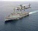 Sikorsky SH-60B Seahawk of HSL-41 flies over USS Denver (LPD-9) on 30 September 1997 (970930-N-0000U-016)