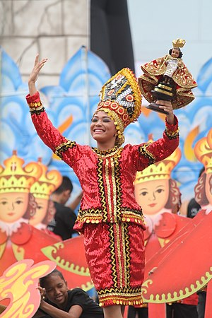 Santo Niño de Cebú - The Sinulog procession includes dancing and fiesta in reverence of Santo Nino. Above, a Sinulog participant carrying a copy of the Santo Nino statue.