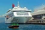 Small green boat and Star Pisces from Tsim Tsa Shui ferry pier, Hong Kong.jpg