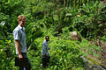 Solomon Water volunteer Louis Downing and counterpart Josh Torren walk down from the Kongula water supply. (10721867643).jpg
