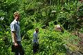 Solomon Water volunteer Louis Downing and counterpart Josh Torren walk down from the Kongula water supply. (10721867643).jpg
