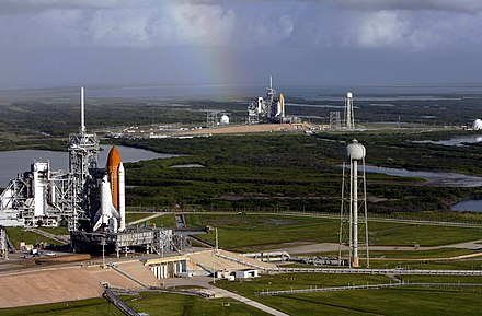 Atlantis and Endeavour on launch pads. This particular occasion is due to the final Hubble servicing mission, where the International Space Station is unreachable, which necessitates having a Shuttle on standby for a possible rescue mission. Space shuttles Atlantis (STS-125) and Endeavour (STS-400) on launch pads.jpg