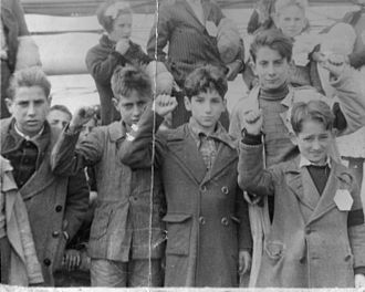 José Brocca - Children preparing for evacuation from Spain.