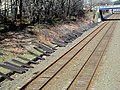 Spare ties at West Newton station, April 2016.JPG