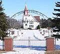 St. John's Evangelical Lutheran Church (Kronborg, Nebraska) W gate.JPG