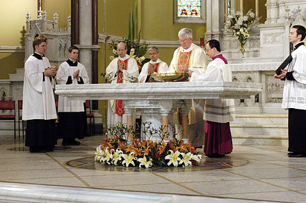 Instituted acolytes assisting at the dedication of an altar StMarysWestMelbAltar.jpg
