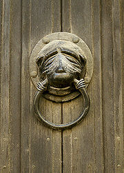 A copy of the original Brasenose Knocker is mounted on a door in Stamford.