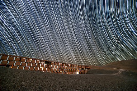 Star trails caused by the Earth's rotation during the camera's long exposure time. Star trails over the Paranal Residencia, Chile.jpg