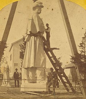 The American Volunteer (statue) - Statue at Westerly, Rhode Island, circa 1876. Note the smaller version, far left.