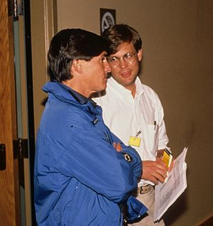 Steve McAlpine - Steve McAlpine (left, in blue jacket) as lieutenant governor in September 1989, talking with Governor Cowper's staff assistant Ernie Piper.