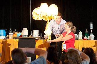 Steve Spangler - Steve Spangler igniting methane-filled bubbles in the hands of a young teacher at Science in the Rockies 2011.