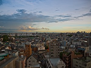 Sunset View of Osaka from the hotel near Moriguchi city station (6059809830).jpg
