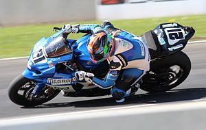 Motorcycle tyre - Elena Myers knee dragging while hanging off her Suzuki GSX-R1000 AMA Superbike at Road America.