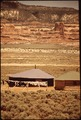 THE HOGAN IS THE TRADITIONAL DWELLING OF THE NAVAJO INDIANS - NARA - 544396.tif