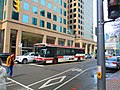 TTC bus, southbound at Bay and Queen's Quay, 2017 04 19 (33345244303).jpg