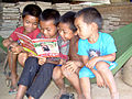 TaOy boys share a book.jpg