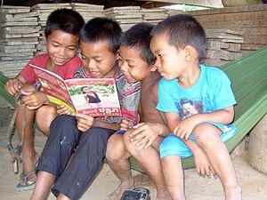 Ta Oi people - Ta Oi boys reading, Salavan Province, Laos