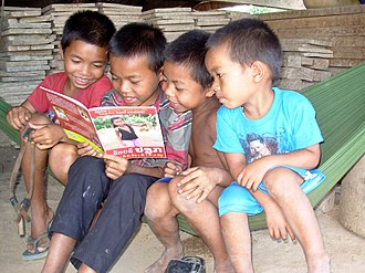 Ta Oi people - Ta Oi boys reading, Salavan Province, Laos