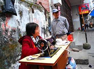 Tailor - A roadside tailor in Haikou City, Hainan Province, China