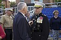 The 35th Commandant of the Marine Corps, Gen. James F. Amos, right, speaks with an attendee following the retirement ceremony for Gen. George J. Flynn, not shown, at Marine Barracks Washington in Washington 130509-M-LU710-425.jpg