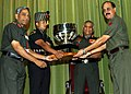The Chief of Army Staff, Gen. V.K. Singh presenting Inter Command Sports Championship Trophy to the GOC-in-C Southern Command, Lt. Gen. A.K. Singh, in New Delhi on April 27, 2011.jpg