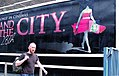 The Decapitator removes Sarah Jessica Parker's head from a Sex and the City movie poster.jpg