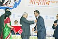 The Prime Minister Shri Atal Bihari Vajpayee conferring Pravasi Bharatiya Samman on the President of the Co-operative Republic of Guyana Mr. Bharat Jagdeo at the inauguration of second Pravasi Bharatiya Divas - 2004 in New Delhi.jpg