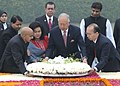 The Prime Minister of Malaysia, Dato' Sri Mohd Najib Tun Abdul Razak and his wife Datin Sri Rosmah Mansor laying wreath, at the Samadhi of Mahatma Gandhi, at Rajghat, in Delhi on January 20, 2010.jpg