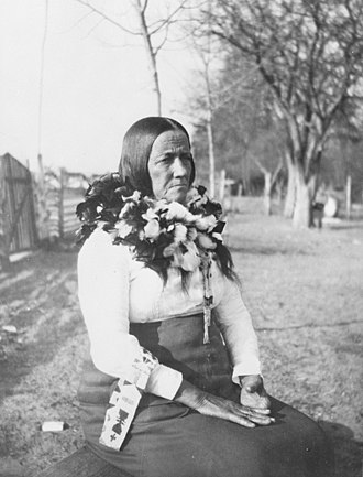 Pamunkey - Theodora Octavia Dennis Cook, wife of Chief George Major Cook, wearing a woven feather neck ornament of wild turkey feathers, wild goose, and shelldrake or shellduck, ca. 1864-ca. 1935