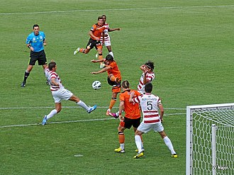 Thomas Broich - Broich (centre, shooting) in action with Brisbane Roar in 2013