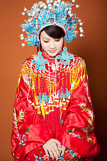 Qing dynasty styled traditional Chinese wedding dress with phoenix crown  headpiece still used in modern Taiwanese weddings.